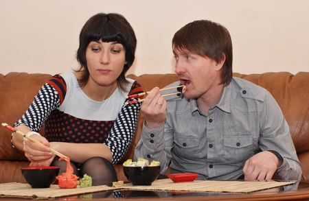 Married couple eating sushi in the dining-room Stock Photo