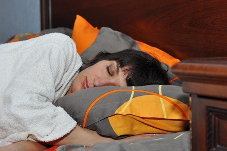 Young woman sleeping in her bedroom Stock Photo