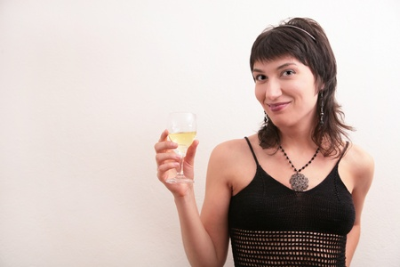 Young woman holding a glass of white wine Stock Photo