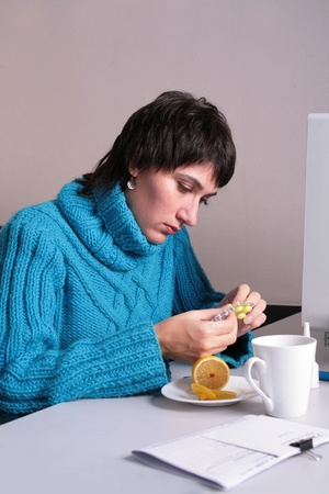 Woman in the office trying to get a tablet to take Stock Photo
