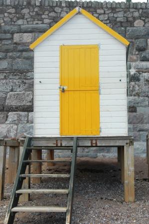 Small yellow and white beach house Stock Photo