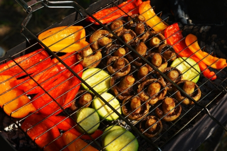 Yellow and red pepper, vegetable marrows and mushrooms cooked on the grill