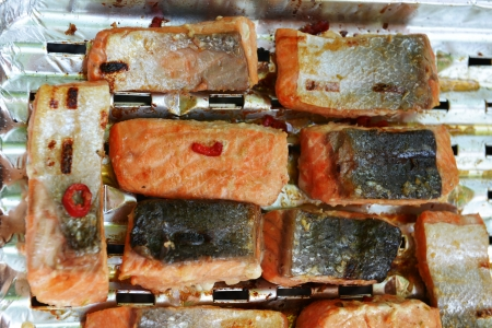 Salmon fillet  with red pepper and spices cooked on the grill