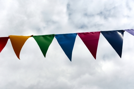 Set of flags of different colours against the cloudy sky Stock Photo
