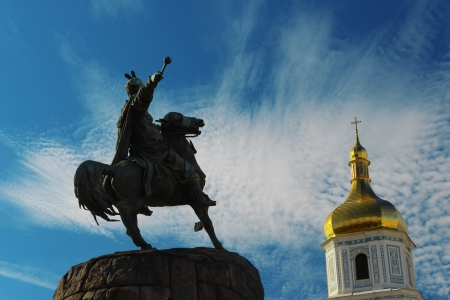Bohdan Khmelnytsky monument and top of Sofia Cathedral on Sofia Square in Kiev, Ukraine Stock Photo