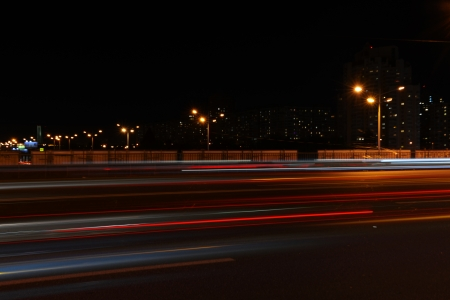 Evening view on the city with blurred moving cars Stock Photo