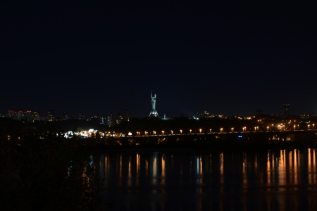 Night view on Kiev with Motherland monument from left bank of Dnieper Stock Photo