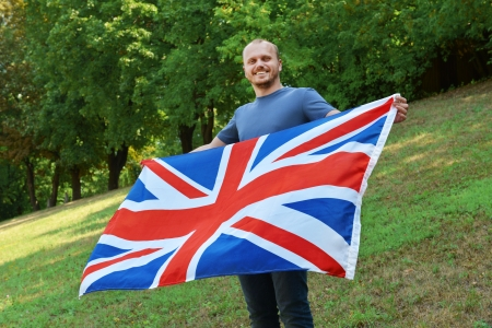 Young man holding the waving Great Britain flag photo