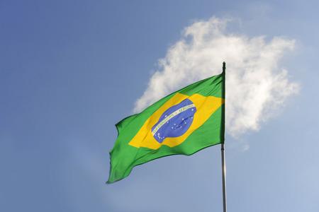 Brazilian flag waving in the sky Stock Photo
