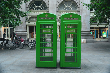 JULY, 2014 - LONDON, UK: two green phone booths in Central London Editorial