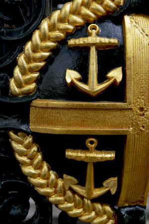 MAY, 2014 - LONDON, UK: golden blazon on the gates in Greenwich University
