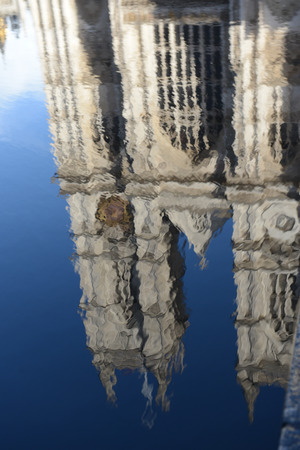 FEBRUARY, 2014 - LONDON, UK: reflection of the Westminster Abbey in puddle on the pavement