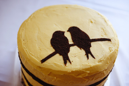 Yellow cake with two birds for the wedding cake