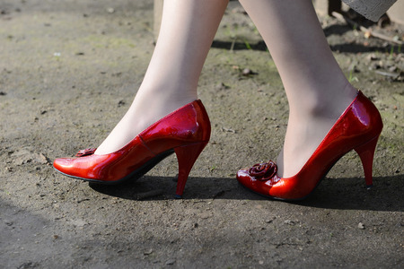 Legs of the woman in red shoes photo