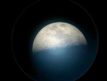 Night moon through telescope ocular Stock Photo