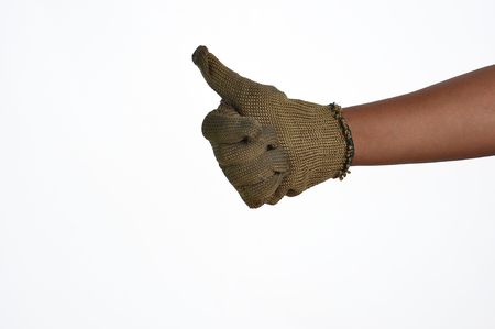 gloved: Gloved thumb holds