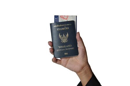 fiestas electronicas: Hand holding Thailand official passport and boarding pass