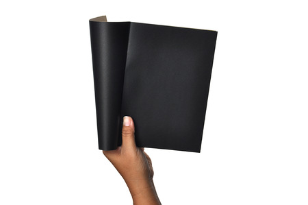 two page spread: A femalewoman hand hold a emptyblank black bookdiary, note spread isolated white at the studio Stock Photo