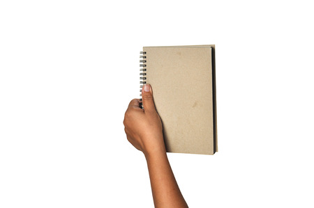 two page spread: hand hold the old bookdiary cover isolated white