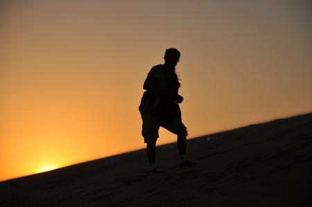ne: Silhouette of Sunset in Red Sand Dunes, Mui Ne, Vietnam