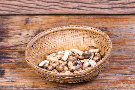 oiled: oiled peanuts on Wood Background Stock Photo