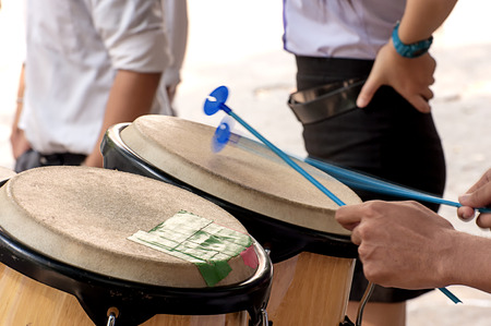 percussionist: Percussionist slap hand on the Conga in school.