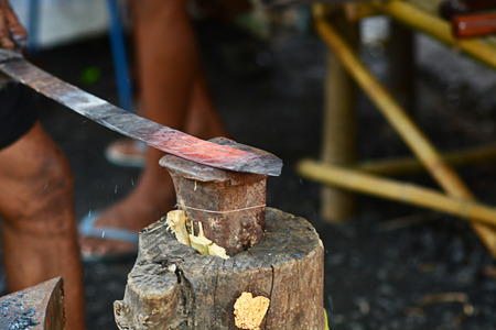 forge: Blacksmith working on metal on anvil at forge detail shot Stock Photo