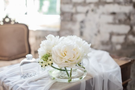 Vase with beautiful david austin roses on a table nice rare stock stock photo vase with beautiful david austin roses on a table nice rare white flowers for rustic wedding decoration loft style fresh bouquet for bride mightylinksfo
