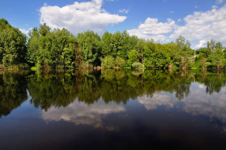 slowly sail cloud in mirror river Stock Photo