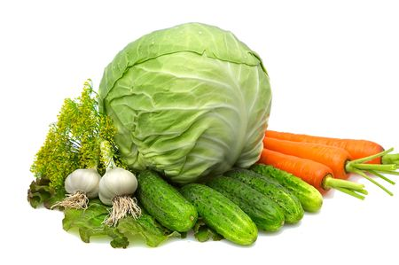 Cabbage,carrot,garlic,cucumbers,dill,lettuce isolated on a whiteground.