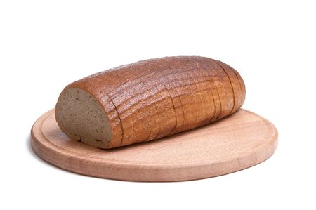 Long loaf and round board isolated on a white background. photo