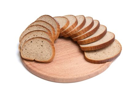Pieces of long loaf and round board isolated on a white background. photo