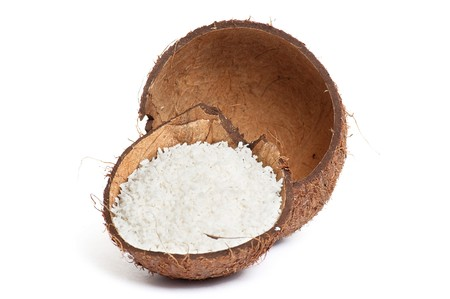 Half part of coconut with powder inside shell isolated on a white background. photo