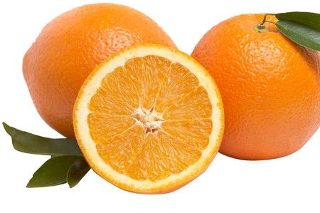 sweet segments: Juicy,ripe oranges and green leaves isolated on a white background.