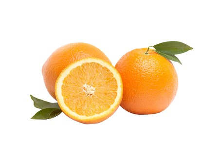 Ripe,juicy oranges and green leaves isolated on a white background. Stock Photo