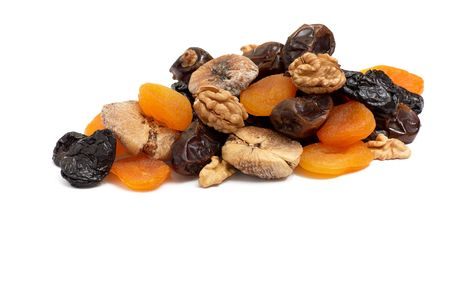 Heap of  different dried fruits and walnuts isolated on a white background. Stock Photo - 4366307