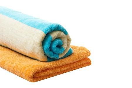 orange washcloth: Turquoise and orange towels isolated on a white background.