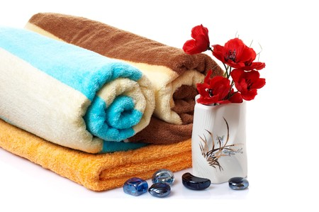 Wonderful stones ,vase with flowers and towels isolated on a white background. Stock Photo - 4490554