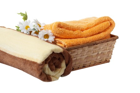 Daisywheel ,towels and basket isolated on a white background. photo