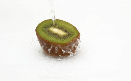 Half of juicy kiwi and cool water. photo