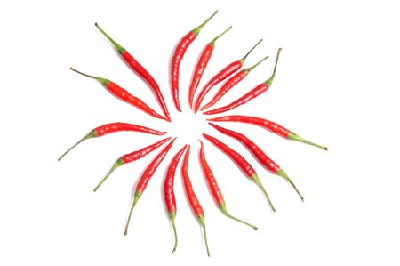 Ripe red chili peppers isolated on a white background.