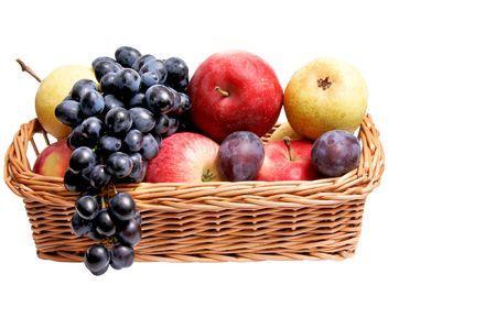 Autumn basket full of  fruits isolated on a white background. photo