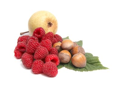 Hazelnuts,pear and raspberries isolated on a white background. photo