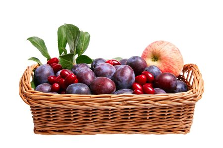 Brown basket full of autumn fruits isolated on a white background. Stock Photo - 5756399