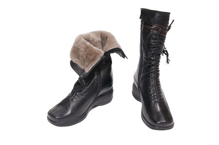 Modern black boots with fur isolated on a white background. photo