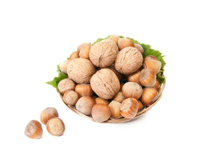 Basket full of autumn nuts isolated on a white background. photo