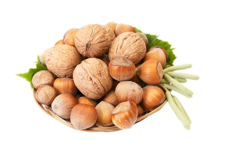 Basket full of autumn nuts with buds isolated on a white background. photo