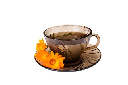 One cup of herbal tea and calendula blossoms isolated on a white background. Stock Photo - 5968388