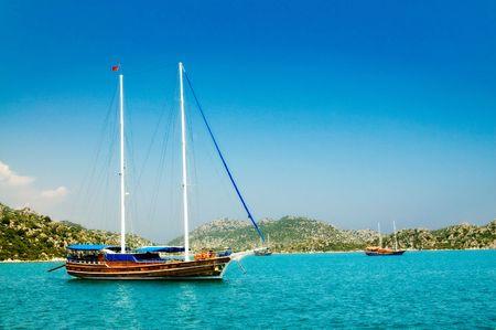 Bay in mediterranean sea with yachts in the Kekova. Turkey.  Stock Photo