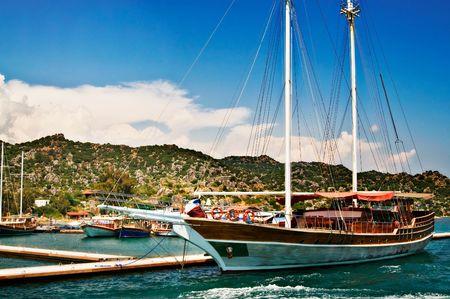 The yachts in bay next to splendid mountains.Kekova. Turkey. photo